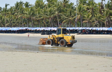 grader: Chonburi Thailand April 5, 2014 bulldozer running for grader smooth sand at Bangsan beach in Thailand