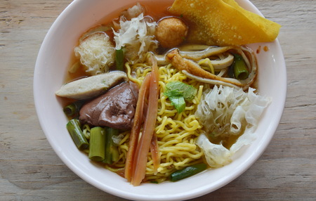 fish ball: Chinese egg noodle with fish ball and crispy squid in soup Stock Photo