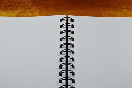 binding: sketchbook binding on wooden table