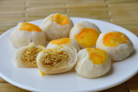 Chinese cake filling sweet nut and salty egg yolk on dish