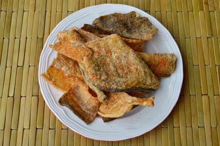 food preservation: crispy fried fish skin with seasoning on dish