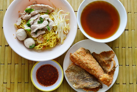 fish skin: Chinese egg noodle topping pork ball and crispy fish skin with soup