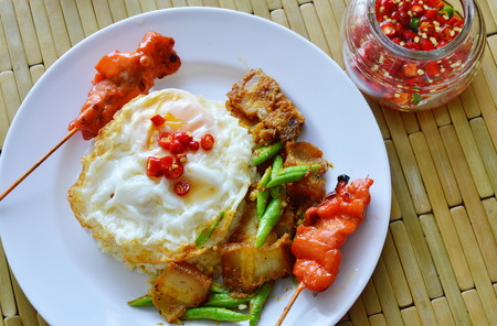 yard stick: spicy stir fried crispy pork curry with egg and roasted pork stick
