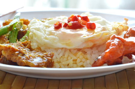 yard stick: spicy stir fried crispy pork curry with egg topping chili on rice
