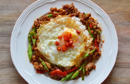 long bean: fried minced pork and yard long bean in sweet chili paste and egg Stock Photo