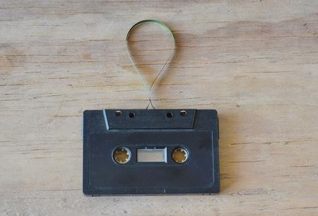 grabadora: audio cassette tape recorder on wooden board