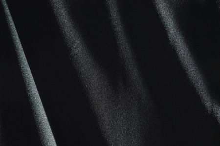 spandex: black fabric in shadow background and texture