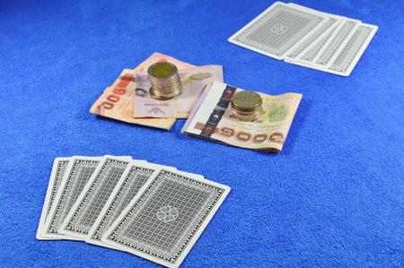 blue velvet: poker card fold and money bet on blue velvet table waiting for challenge