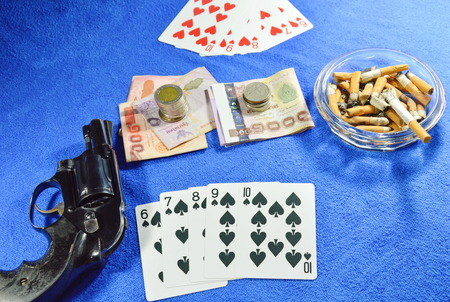 threaten: straight flush win poker game and gun for threaten rival Stock Photo