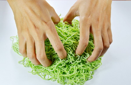 hand thresh raw Chinese jade noodle prepare to cook Stock Photo