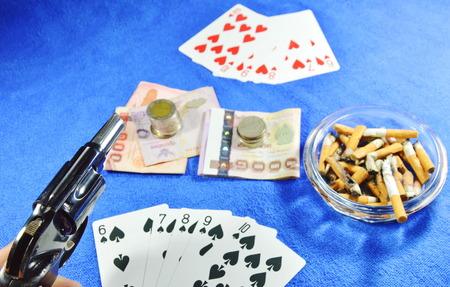 winner poker game pointing gun for threaten rival