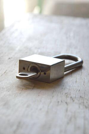 master key unlocked on wooden board Stock Photo