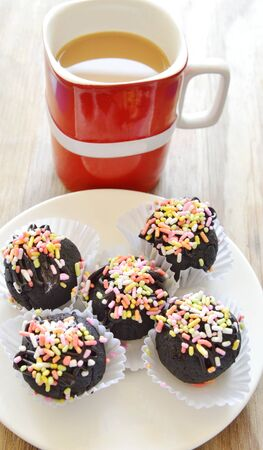 chocolate ball topping colorful candy eat couple with coffee