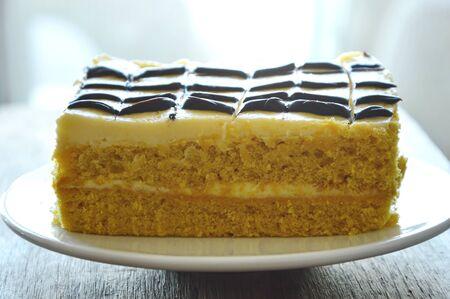 vanilla cake: vanilla cake decorate cream and chocolate on dish Stock Photo