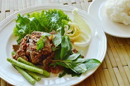 chitterlings: spicy minced pork and liver salad eat couple with sticky rice on dish Stock Photo
