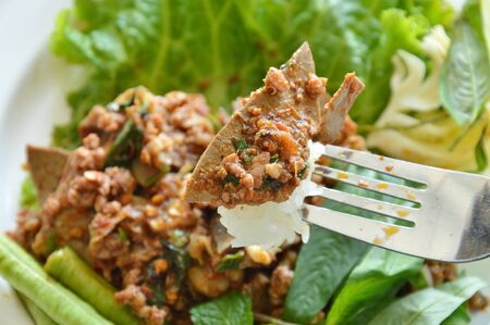 chitterlings: spicy pork liver salad with sticky rice stab in fork
