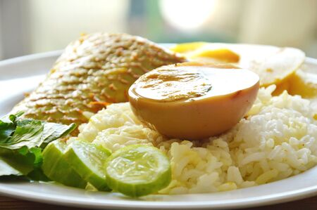 boiled brown egg with mango fish bamboo shoot in spicy and sour soup on rice