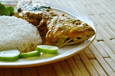 boiled mackerel in spicy curry sauce eat couple with rice and vegetable