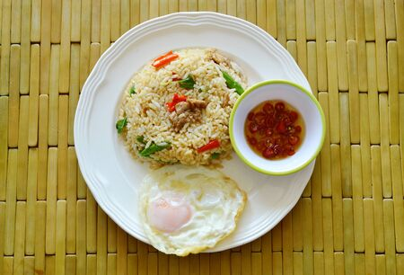 long bean: spicy fried rice pork and basil leaf with fried egg on dish