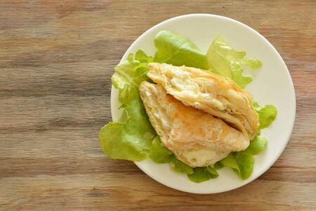 crispy chicken pie dressing mayonnaise with green oak on dish