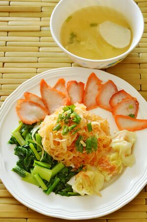 dried thin rice noodle topping barbecue pork and dumpling with soup Stock Photo