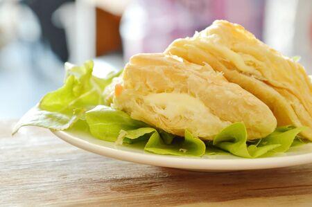 crispy chicken pie dressing cream sauce with green oak on plate