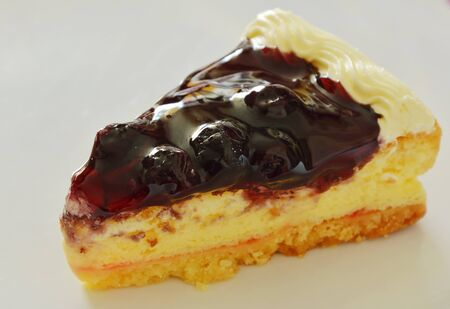 blueberry cheese cake cut for piece on white plate Stock Photo
