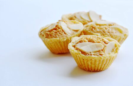 butter cookies cup topping slice almond on white background
