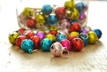 colorful bells rolling on wooden board
