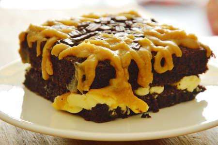 chocolate butter cake dressing brown sweet caramel cream on plate Stock Photo