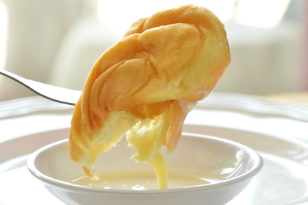 twist bread dipping sweetened condensed milk stab in fork