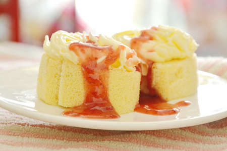 butter jam roll topping vanilla cream dressing strawberry sauce on plate