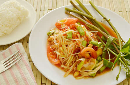long bean: Somtum Thai green papaya salad tasted spicy sour and sweet eat couple with sticky rice