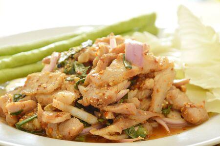 Thai spicy slice pork salad with fresh vegetable on plate