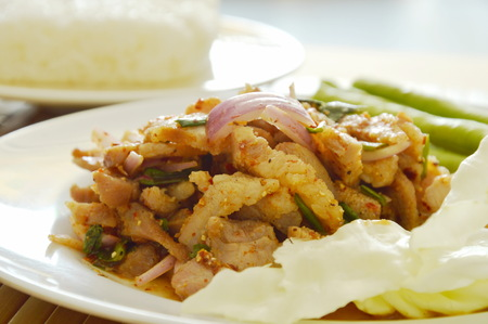 long bean: Thai spicy slice pork salad eat couple with sticky rice and fresh vegetable