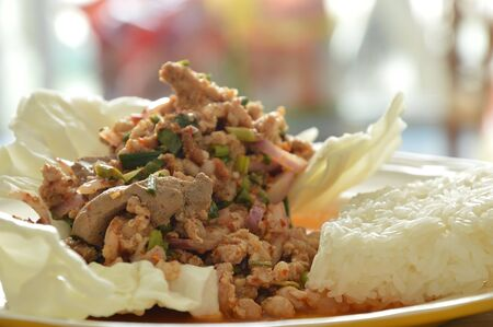 carbohydrates: Thai spicy minced pork salad eat couple with sticky rice and fresh vegetable