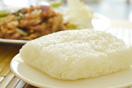 long bean: sticky rice eat couple with Thai spicy slice pork salad and fresh vegetable Stock Photo