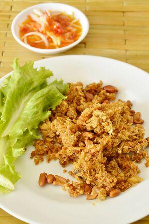 crispy fried chop catfish with green mango salad and sauce