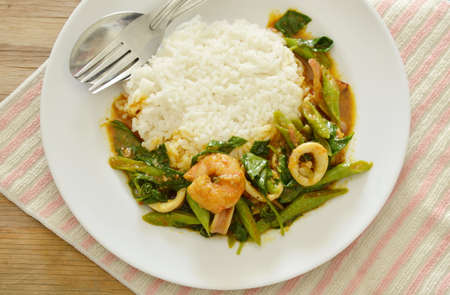 long bean: spicy stir fried shrimp and squid curry eat couple with rice