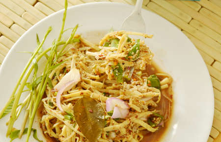 digest: spicy shredded bamboo shoot salad in Thai northeastern style scooping on fork Stock Photo