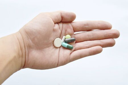 thump: medicine and capsule on human hand in white background Stock Photo