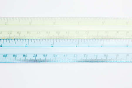 colorful plastic ruler on white background Фото со стока