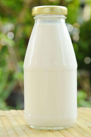 bottle of milk on bamboo mat in garden