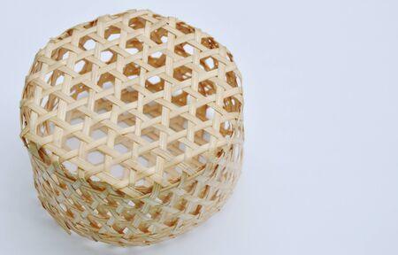 basketry: circle woven bamboo basket on white background Stock Photo