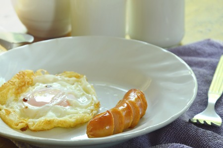 albumen: fried egg and pork sausage eat couple with milk breakfast set