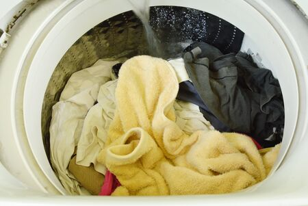 applied: water flowing on cloth in washing machine drum operated to wash