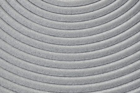 curve of gray fiber insulation sheet keeping by rolling