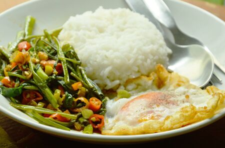 stir fried morning glory chop chili and egg eat couple with rice