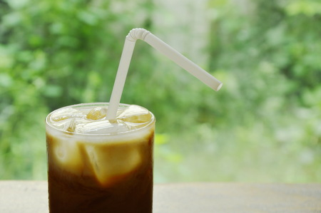 ice coffee topping milk floating with straw in glass Stok Fotoğraf