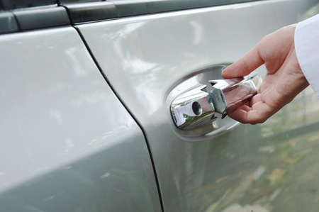 car door handle opened by hand up and pulling